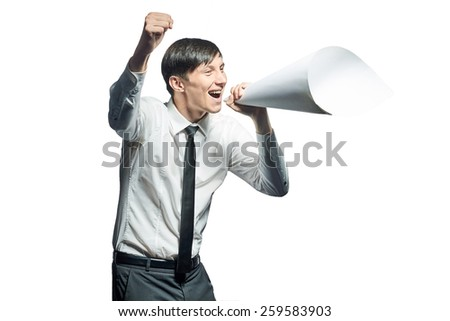 Young businessman shouting with a papers megaphone on white background - stock photo