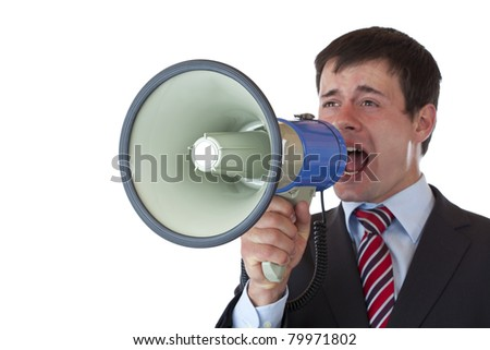 Young businessman shouts loudly into megaphone.Isolated on white background. - stock photo