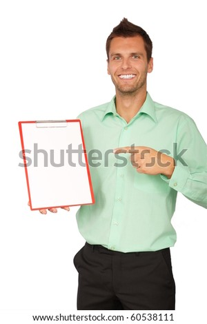 Young businessman showing a blank paper. There you can write a text - stock photo