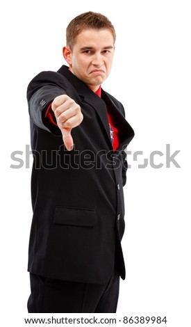Young businessman showing disappointment/disapproval with thumbs down - stock photo