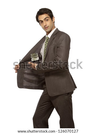 young businessman showing rupees note in pocket - stock photo