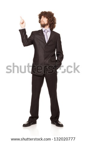 young businessman showing something with his forefinger isolated on white background - stock photo