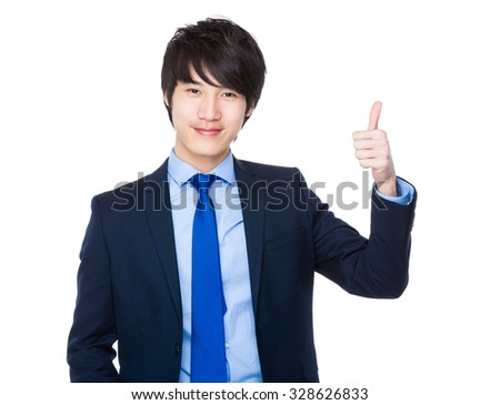 Young Businessman showing thumb up - stock photo