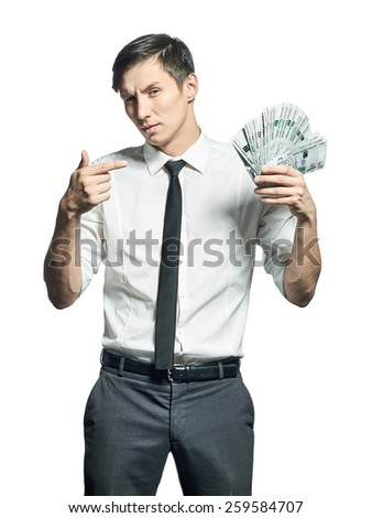 Young businessman shows a wad of cash in hand  isolated on white background. - stock photo