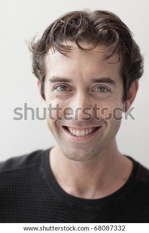 Young businessman smiling - stock photo