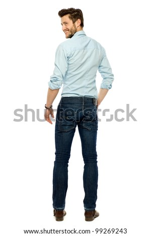 Young businessman standing - stock photo