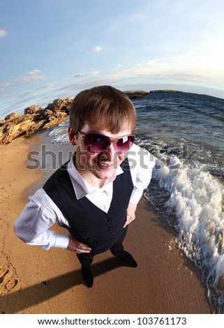 Young businessman standing against nature landscape background - stock photo