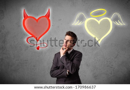 Young businessman standing and choosing between the angel and the devil heart - stock photo