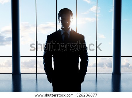 young businessman standing in airport - stock photo