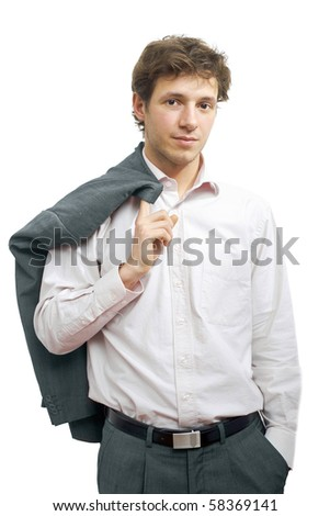 Young businessman standing in confident pose with hands in pocket and his suit draped over his shoulder. Isolated on white. - stock photo