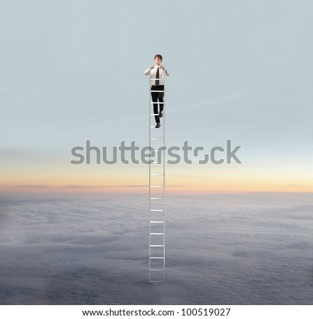 Young businessman standing on a ladder in the sky - stock photo