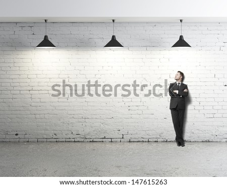 young businessman standing on loft - stock photo