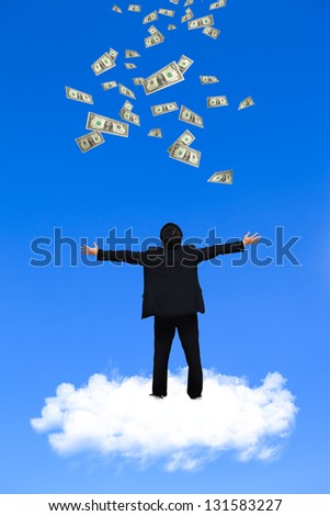 Young businessman standing on the cloud with a lot of falling dollars - stock photo