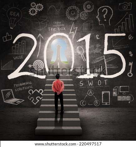 Young businessman standing on the stairway and look a door to success in 2015 - stock photo