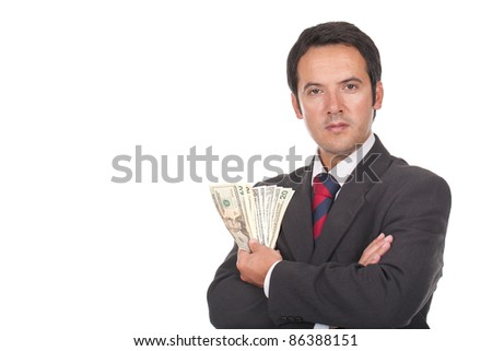 young businessman standing with a lot of dollar bills on his hand - stock photo