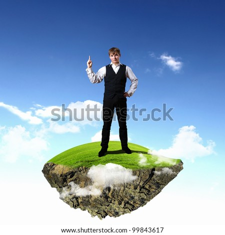 Young businessman standing with his hand and finger up - stock photo