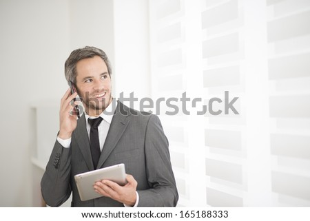 young businessman surfing on tablet - stock photo