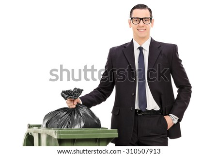young businessman taking out the trash isolated on white background - stock photo