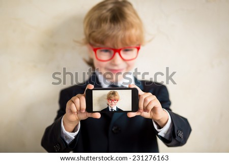 Young businessman taking selfie. Success in business and communication concept - stock photo
