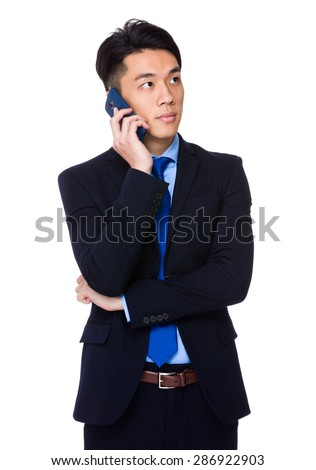 Young businessman talk to mobile phone - stock photo