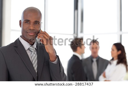 Young Businessman talking on cellphone - stock photo