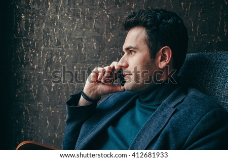 Young businessman talking on smart phone - stock photo