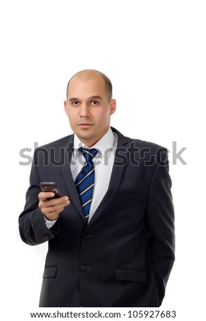 Young businessman texting - Portrait shot of a young well dressed businessman with a cell phone isolated on white background - stock photo