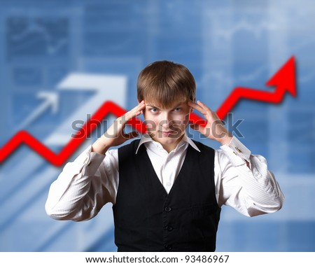 Young businessman thinking and analyzing financial graphs - stock photo