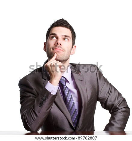 Young businessman thinking hard about a problem - stock photo