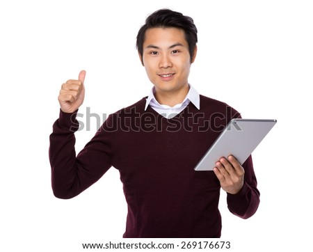 Young businessman thumb up sign with tablet computer - stock photo