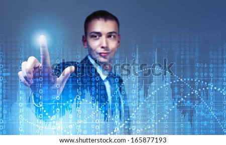 Young businessman touching icon of media screen with binary code - stock photo