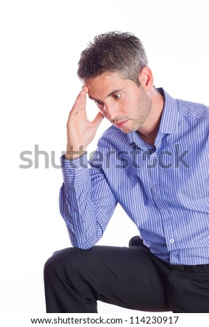 Young businessman under stress, fatigue and headache, he kept his hand behind his head. - stock photo