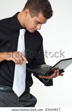 Young businessman uses laptop - stock photo