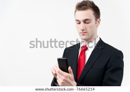 young businessman using a smart phone - stock photo