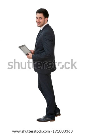 Young businessman using digital tablet, isolated - stock photo