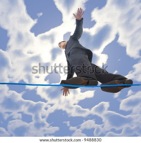 Young businessman walking on line in the air. Holding balance. Low angle view - stock photo