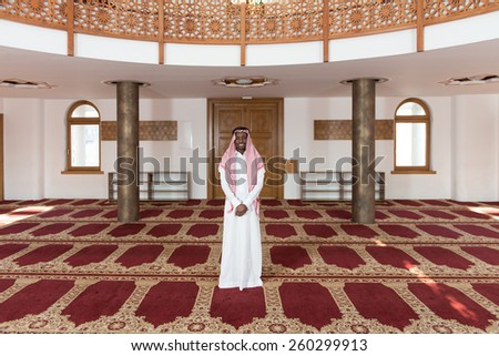 Young Businessman Wearing A Traditional Cap Dishdasha - stock photo