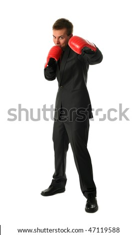 Young businessman wearing boxing-gloves isolated on white - stock photo
