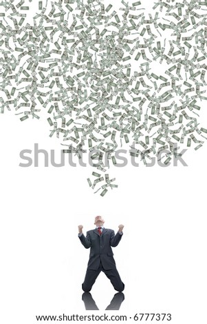 Young businessman with a lot of falling dollars - stock photo