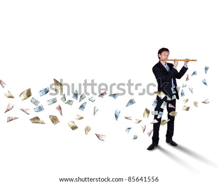 Young businessman with banknotes all around him - stock photo