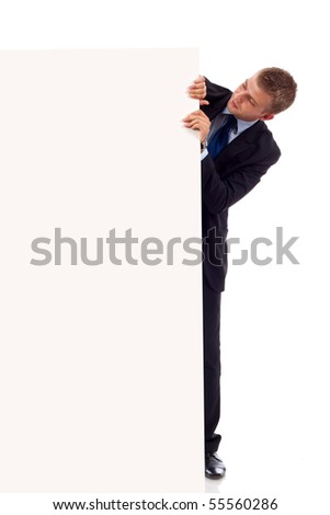 Young businessman with blank board isolated on white - stock photo