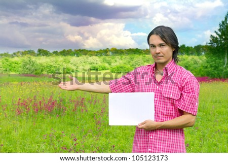 young businessman with blank paper - outdoor environment - stock photo