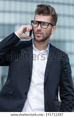 young businessman with cell phone - stock photo