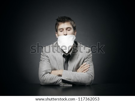 Young  businessman with censorship gag on his month - stock photo