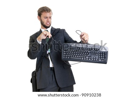 Young businessman with computer keyboard isolated in white - stock photo