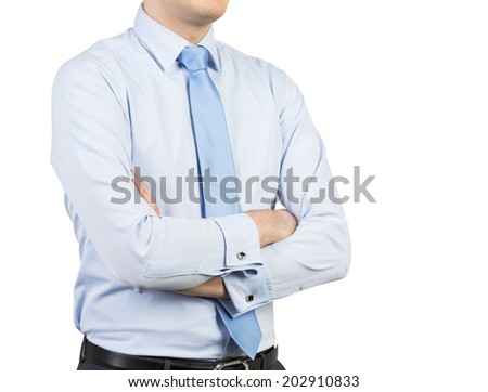 Young businessman with crossed hands isolated in white - stock photo