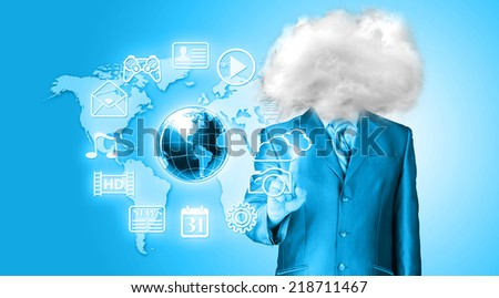 Young businessman with head in the clouds - stock photo