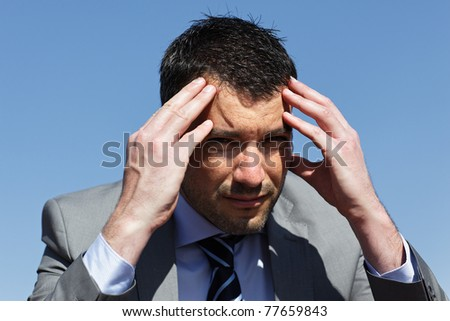 young businessman with head in the hands - stock photo