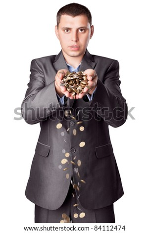 young businessman with heap of coins isolated on white background - stock photo