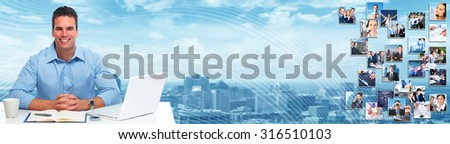 Young businessman with laptop computer in the office. - stock photo